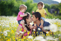 Happy family. Happy young family with twins resting outdoors Stock Photos