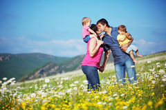 Happy family. Happy young family with twins resting outdoors Stock Photo