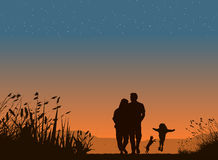 Happy family. Silhouette of family on sunset Royalty Free Stock Photo