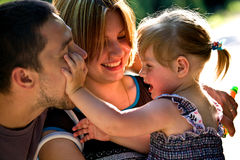 Happy family. Joy, father, mother and doghter Royalty Free Stock Images
