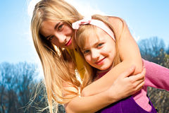 Happy Family. Happy sisters having fun at summer park Royalty Free Stock Photography