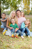 Happy family. Happy large family with children in autumn park Stock Image