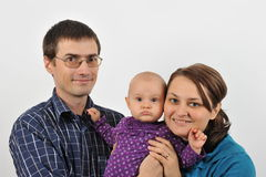 Happy family. Portrait with happy parents and baby girl Royalty Free Stock Photography