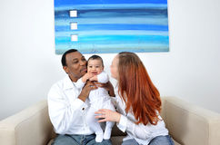 Happy family. Portrait with happy parents and baby boy Stock Photography