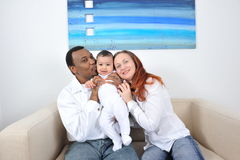 Happy family. Portrait with happy parents and baby boy Stock Photos