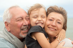 Happy family. Portrait of happy grandparents and grandchild Stock Photo