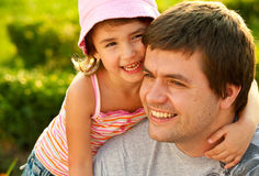 Happy family. Happy young girl hugging father or dad outdoors. happy family stock photography