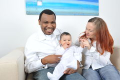 Happy family. Portrait with happy parents and baby boy Royalty Free Stock Images