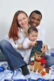 Happy family. Portrait with happy parents and baby boy Royalty Free Stock Photo