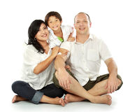 Happy family. Beautiful mixed race family - isolated over a white background Royalty Free Stock Photo