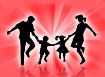 Happy family. Jumping and dancing in the sunrays Royalty Free Stock Photos