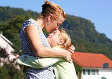 Happy family. Happy mom with a girl in the nature royalty free stock image
