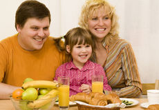Happy family. Have a breakfast at the table Royalty Free Stock Photos