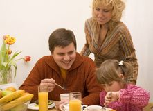 Happy family. Have a breakfast at the table Stock Photo