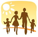 Happy family. Stylized silhouettes of the happy family on a yellow background Royalty Free Stock Photos