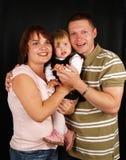 Happy family. Happy young family in studio Stock Photo