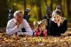 Happy family. In  autumn park Royalty Free Stock Images