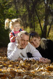 Happy family. In  autumn park Stock Images