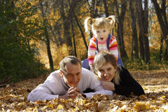 Happy family. In  autumn park Royalty Free Stock Photography