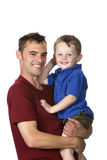 Happy family. A young man holds a happy child in his arms Royalty Free Stock Photo