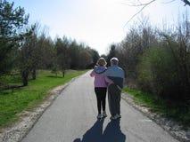 Happy family. Elderly couple walking together Stock Image