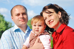 Happy family. Happy smiling family,parents and little girl Royalty Free Stock Images
