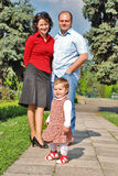 Happy family. Happy smiling family,parents and little girl Stock Image