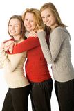 Happy family. Mother and her daughers have fun in their group portrait Stock Images