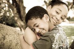 Happy family. Happy african american family concept: mother and son hugging royalty free stock images