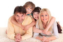 Happy family. Portrait of a happy family with two children. One girl and one boy. Isolated against a white background stock photos