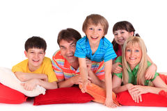 Happy Family. Parents and children laying on pillows. Isolated against a white background stock photo