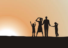 Happy family. Silhouette family of four, overjoyed, shouting at the sun Stock Image