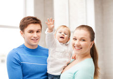 Happy family with adorable baby Stock Images
