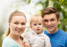 Happy family with adorable child Stock Images