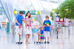 Happy family at the airport Stock Image