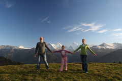 Happy family in Alps Stock Photos
