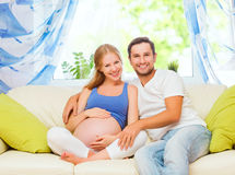 Happy family in anticipation of the birth of baby. Pregnant woma Royalty Free Stock Photography