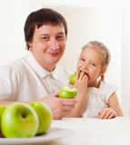 Happy family with apples Stock Photos