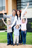 Happy family with arms up Stock Photo