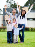 Happy family with arms up Stock Photos