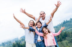 Happy family with arms up Stock Photography