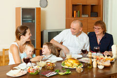Happy family around festive table Royalty Free Stock Photos