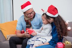 Happy family Asia family wear santa claus hat exchange Christmas royalty free stock photography