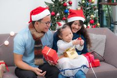 Happy family Asia family wear santa claus hat exchange Christmas Royalty Free Stock Images