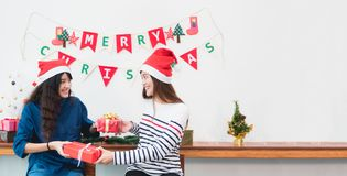 Happy family Asia family wear santa claus hat unwrap Christmas g Stock Photography