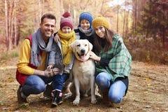 Happy family during autumn Stock Photo