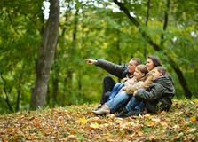 Happy family in autumn forest Royalty Free Stock Images