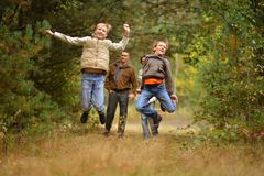 Happy family in autumn forest Royalty Free Stock Photography