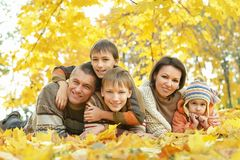 Happy family in autumn forest Royalty Free Stock Photo