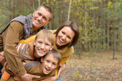 Happy family in autumn forest Stock Photo